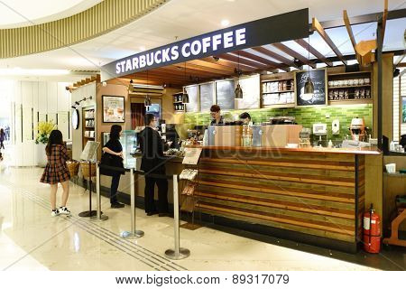 HONG KONG - APRIL 16, 2015: Starbucks Cafe in shopping mall. Starbucks Corporation is an American global coffee company and coffeehouse chain based in Seattle, Washington