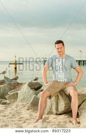 Fashion Portrait Of Handsome Man On The Beach