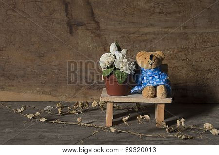 Brown Bear And Jasmine Sitting On Wood Table Wood Background ,still Life For Happy Mother Day.