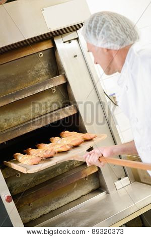 Fresh baguettes coming out of the oven