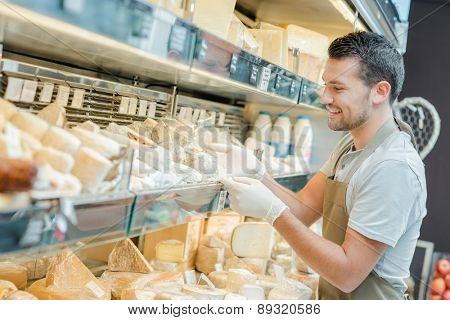Man working in a cheese shop