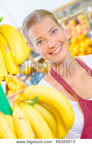 Shop assistant checking bananas