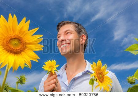 resting man holding flower smile while