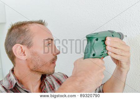 Man using a cordless drill