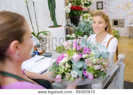 Florist serving a young lady