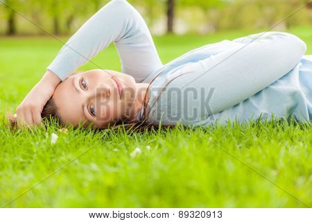 relaxing female on the ground
