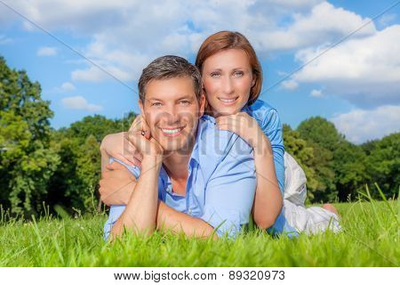 relaxing wellbeeing couple smiling for new garden