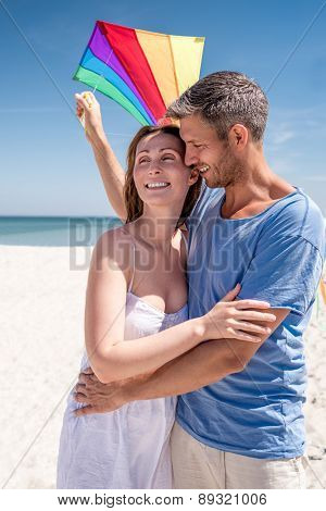 lifestyle couple on bright beach on day