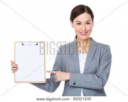 Asian businesswoman with finger point to blank clipboard