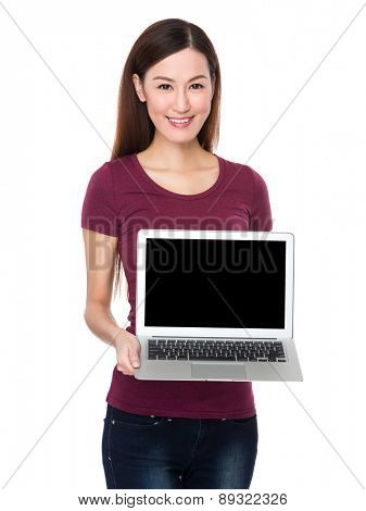 Asian woman show with blank screen of laptop computer