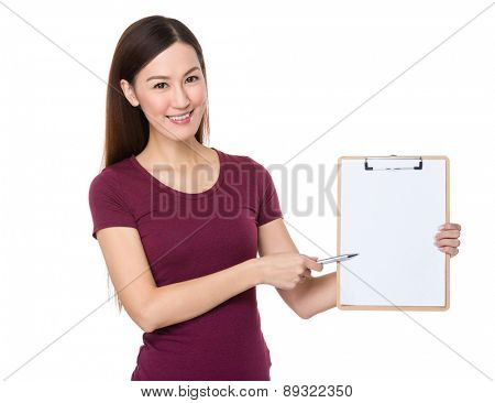 Asian woman pen point to blank clipboard