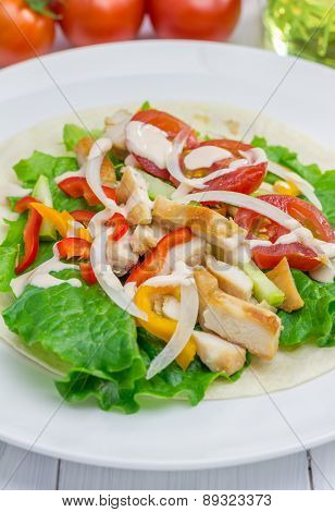 Roasted Chicken Fillet On Wheat Tortilla With Salad Of Fresh Vegetables