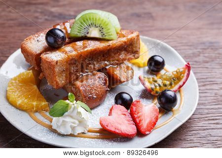 French toast and fresh fruit with caramel sauce