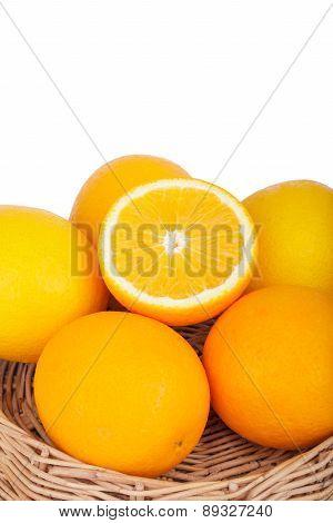Fresh Orange Fruits In Basket On Wood