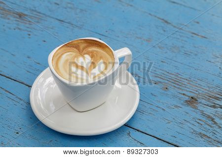 Cup Of Latte Coffee On Blue Wooden