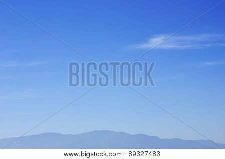 Mountain And Clouds In The Blue Sky Background
