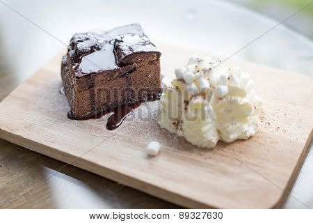 Elegant Still Life Of Chocolate Frosted Brownie