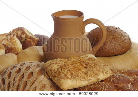 Bread, Rolls, Muffins And A Jug Of Milk