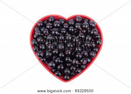 Currants In A Dish In The Shape Of A Heart.