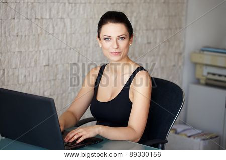 Brunette Accountant Typing On Laptop In Office