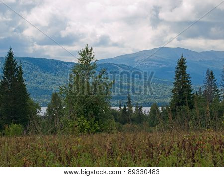 Mountains in the forest on a cloudy day in Siberia