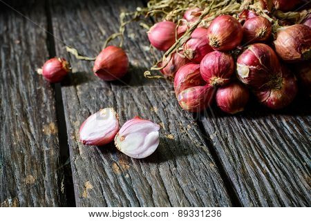 Shallot Onions On Old Wooden Table