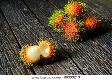 Close Up Of Rambutan On Old Wood Table
