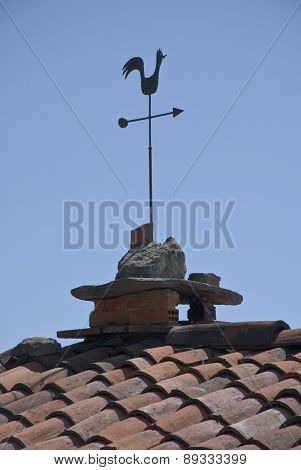 the fireplace with the rooster weathervane