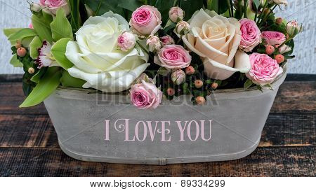 Romantic Bouquet Of Roses And Love Sign