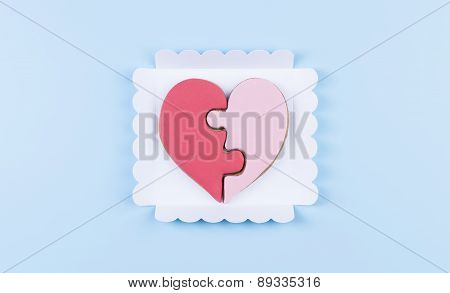 Broken Heart Biscuits On A Turquoise Background