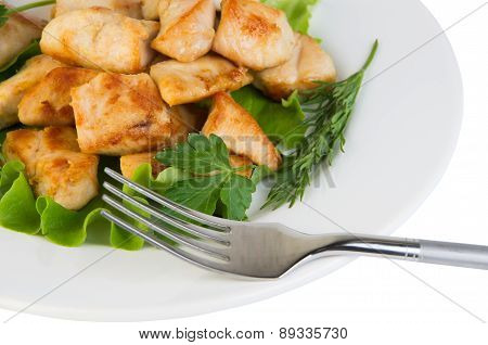 Fried Pieces Of Chicken Meat On Plate And Fork