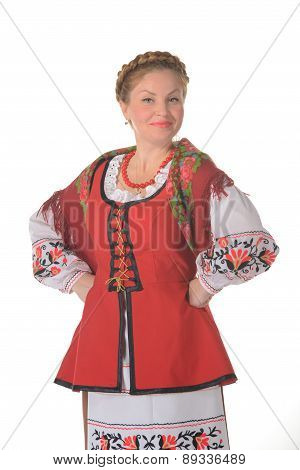 Young blonde woman dressed in traditional folk costume