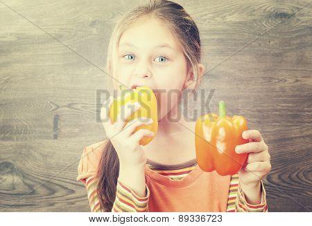 little girl eating vegetables