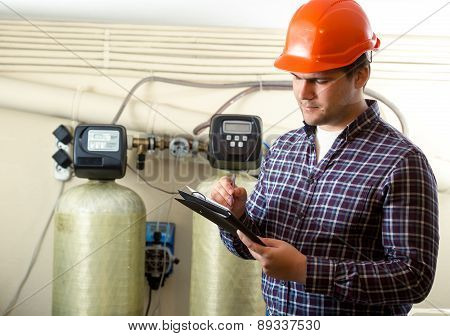 Inspector Checking Work Of Factory Equipment