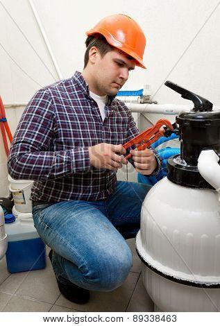 Plumber Installing Manometer On High Pressure Barrel