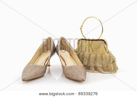 Collection Of Golden Shoes And Bag .