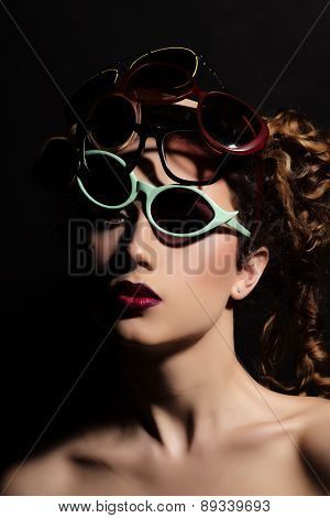 Woman In Many Glasses