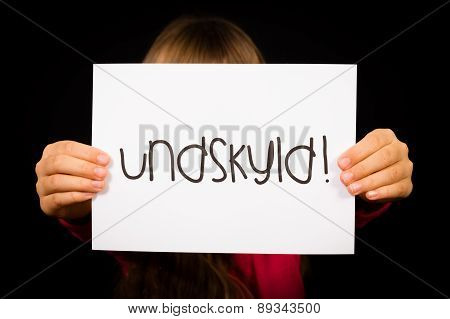 Child Holding Sign With Danish Word Undskyld - Sorry
