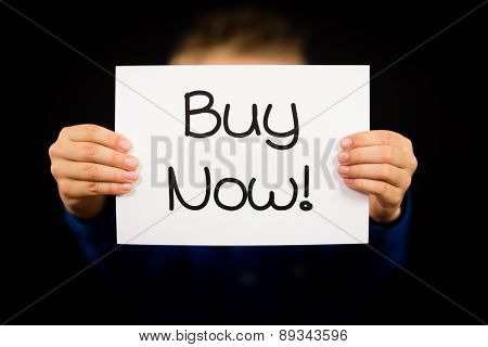 Child Holding Buy Now Sign