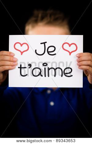 Child Holding Sign With French Word Je T Aime - I Love You