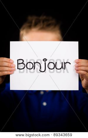 Child Holding Sign With French Word Bonjour - Hello