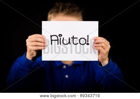 Child Holding Sign With Italian Word Aiuto - Help