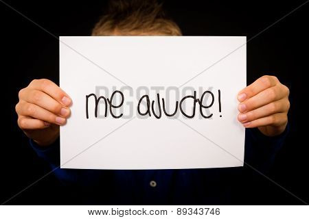 Child Holding Sign With Portuguese Words Me Ajude - Help Me
