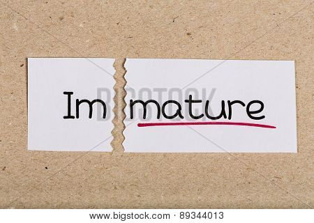 Sign With Word Immature Turned Into Mature