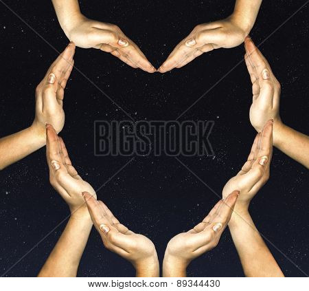 woman's hands make heart shape