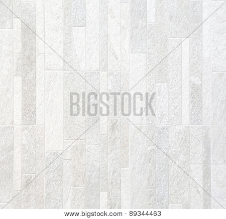 light grey stone wall.