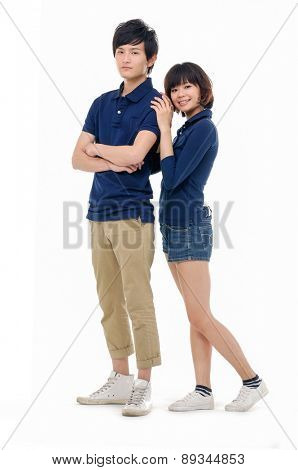 Full body portrait of couple the side standing posing