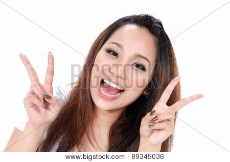 Closeup asian young woman raising her arm in sign of victory