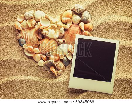 Beach sea sand with vintage empty photo cards. Summer style background. Space for your text.