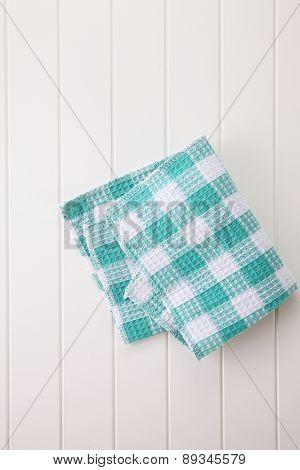 checkered napkin on wooden white  table
